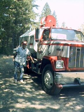 Lairy Dobbins, his grandson, and his water truck