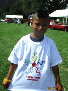 A Karuk child colored a t-shirt at the Karuk Tribal Reunion in Happy Camp, California.